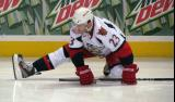 Triston Grant stretches on the ice during pre-game warmups before a Grand Rapids Griffins game.