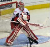 Tom McCollum blocks a shot during pre-game warmups before a Grand Rapids Griffins game.