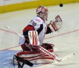 Tom McCollum knocks aside a shot during pre-game warmups before a Grand Rapids Griffins game.