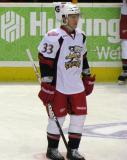 Luke Glendening stands in the neutral zone during pre-game warmups before a Grand Rapids Griffins game.