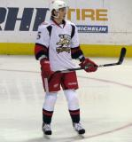 Adam Almquist skates backwards through the right faceoff circle during pre-game warmups before a Grand Rapids Griffins game.