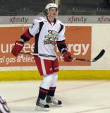 Adam Almquist skates in the corner during pre-game warmups before a Grand Rapids Griffins game.