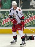 Andrej Nestrasil reaches for a puck during pre-game warmups before a Grand Rapids Griffins game.