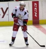 Adam Almquist watches his pass during pre-game warmups before a Grand Rapids Griffins game.