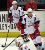 Gustav Nyquist and Tomas Tatar turn along the boards during pre-game warmups before a Grand Rapids Griffins game.