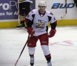 Riley Sheahan skates at center ice during a stop in a Grand Rapids Griffins game.