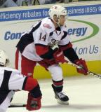 Chad Billins pokes at the puck during a Grand Rapids Griffins game.