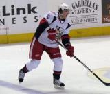Adam Almquist sends a pass along the blue line during a Grand Rapids Griffins game.