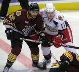 Andrej Nestrasil of Grand Rapids lines up against Darren Archibald of Chicago for a faceoff in a game between the Griffins and Wolves.