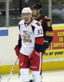 Brian Lashoff skates in front of Darren Haydar during a stop in play in a game between the Grand Rapids Griffins and the Chicago Wolves.