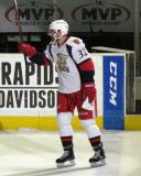 Brian Lashoff raises his stick to the crowd while taking a turn on the ice after being named first star of the game.