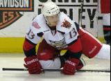 Gustav Nyquist stretches on the ice during pre-game warmups before a Grand Rapids Griffins game.