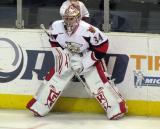 Petr Mrazek stretches along the boards during pre-game warmups before a Grand Rapids Griffins game.