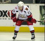 Gustav Nyquist crouches near the boards during pre-game warmups before a Grand Rapids Griffins game.