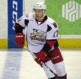 Brent Raedeke skates across the blue line during pre-game warmups before a Grand Rapids Griffins game.