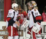 Tomas Tatar and Petr Mrazek talk at the bench during pre-game warmups before a Grand Rapids Griffins game.