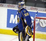 Mike McKenna of the Peoria Rivermen gets set in his crease during pre-game warmups before a game against the Grand Rapids Griffins.