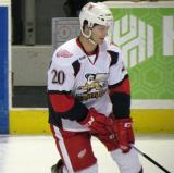 Gleason Fournier picks up the puck during pre-game warmups before a Grand Rapids Griffins game.