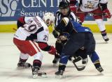 Landon Ferraro of the Grand Rapids Griffins takes a faceoff against T.J. Hensick of the Peoria Rivermen.