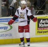 Tomas Tatar takes a look at his stick during a stop in play in a Grand Rapids Griffins game.