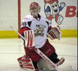 Tom McCollum gets up from stretching during a stop in play in a Grand Rapids Griffins game.