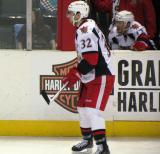 Brian Lashoff gets set for a faceoff in a Grand Rapids Griffins game, with Gustav Nyquist over his shoulder on the bench.