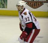 Brian Lashoff gets set for a faceoff during a Grand Rapids Griffins game.
