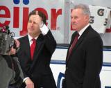 Fox Sports Detroit's Ken Daniels gives a thumbs up while standing next to Mickey Redmond before filming a segment at the Red and White Game.