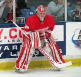Tom McCollum crouches along the boards during pre-game warmups before the Red and White Game.