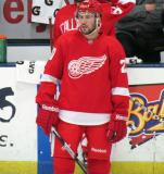 Drew Miller stands near the bench during pre-game warmups before the Red and White Game.