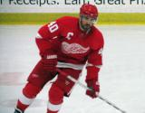 Henrik Zetterberg skates through the neutral zone during pre-game warmups before the Red and White Game.