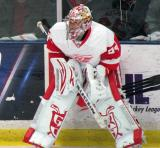 Petr Mrazek crouches along the boards during pre-game warmups before the Red and White Game.