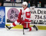 Francis Pare stretches along the boards during pre-game warmups before the Red and White Game.