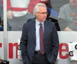 Red Wings associate coach Tom Renney stands at the bench during pre-game warmups before the Red and White Game.