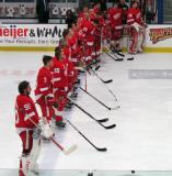 The Red Team lines up for the singing of The Star-Spangled Banner before the Red and White Game.