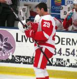 Mike Knuble fixes his helmet near the bench at the start of the Red and White Game.