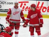 Johan Franzen and Damien Brunner line up on opposite wings for the opening faceoff of the Red and White Game.