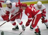 Trevor Parkes and Francis Pare of the White Team line up for a faceoff opposite Tomas Jurco of the Red Team during the Red and White Game.