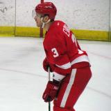 Brennan Evans gets set for a faceoff during the Red and White Game.