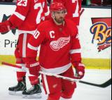 Henrik Zetterberg skates away from the bench during a stop in play in the Red and White Game.