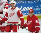 Mike Knuble and Damien Brunner laugh before a faceoff during the Red and White Game.