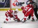 Justin Abdelkader of Team White takes a faceoff against Henrik Zetterberg of Team Red during the Red and White Game.