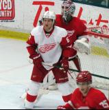 Justin Abdelkader of Team White sets up in front of Team Red goalie Jonas Gustavsson during the Red and White Game.