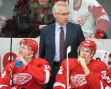 Red Wings associate coach Tom Renney stands behind Gustav Nyquist and Louis-Marc Aubry on the Red Team bench during the Red and White Game.
