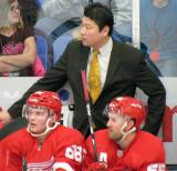 Grand Rapids Griffins assistant coach Jim Paek stands behind Chad Billins and Niklas Kronwall on the Red Team bench during the Red and White Game.