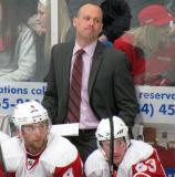 Grand Rapids Griffins head coach Jeff Blashill stands behind Jakub Kindl and Adam Almquist on the White Team bench during the Red and White Game.