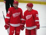 Drew Miller and Cory Emmerton talk during a stop in play in the Red and White Game.