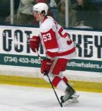 Adam Almquist gets set at the point during the Red and White Game.