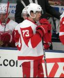 Jeff Hoggan stands at the bench during a stop in play in the Red and White Game.