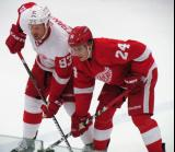 Team White's Johan Franzen and Team Red's Damien Brunner line up at wing for a faceoff during the Red and White Game.